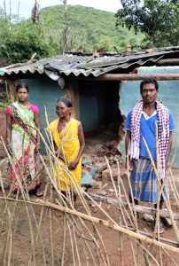 Damaged home of Kanduru Muduli right with his mother and daughter in Badaguda Odisha state India Morning Star News 202x300